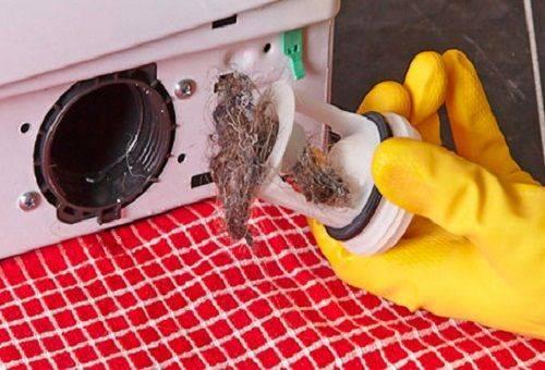 Достаем сливной фильтр стиральной машины