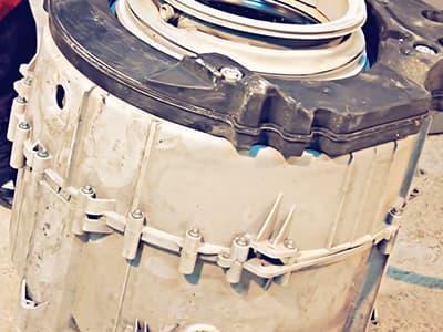 Разборный бак на саморезах-винтах в стиральной машине Electrolux