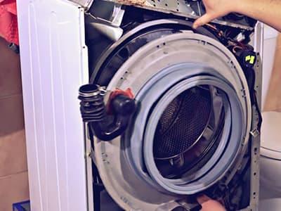 Демонтаж передней крышки бака стиральной машины